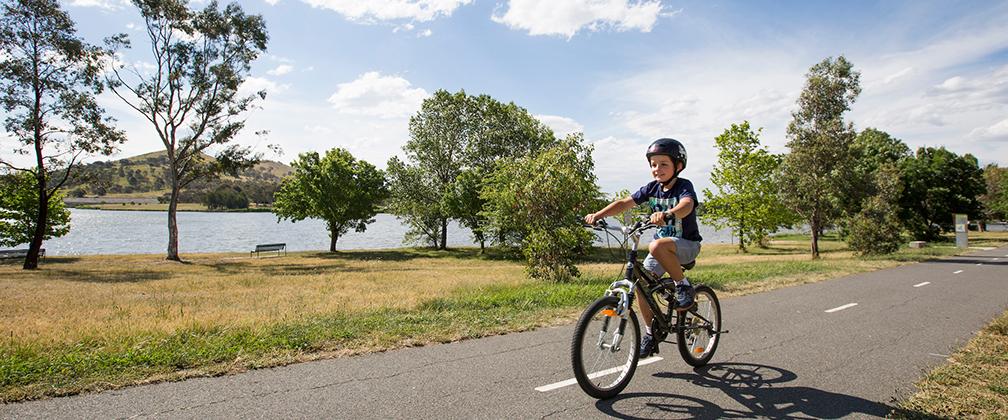 Child riding a bike at Lake