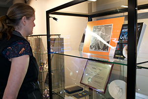 Jan Thurling from Libraries ACT looking at a display at the ACT Heritage Library and ArchivesACT in Fyshwick.