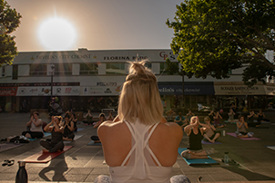Woman teaching yoga in Garema Place.