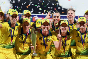 Australian women's cricket team celebrating.