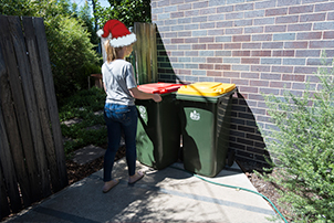 Woman taking out bins.