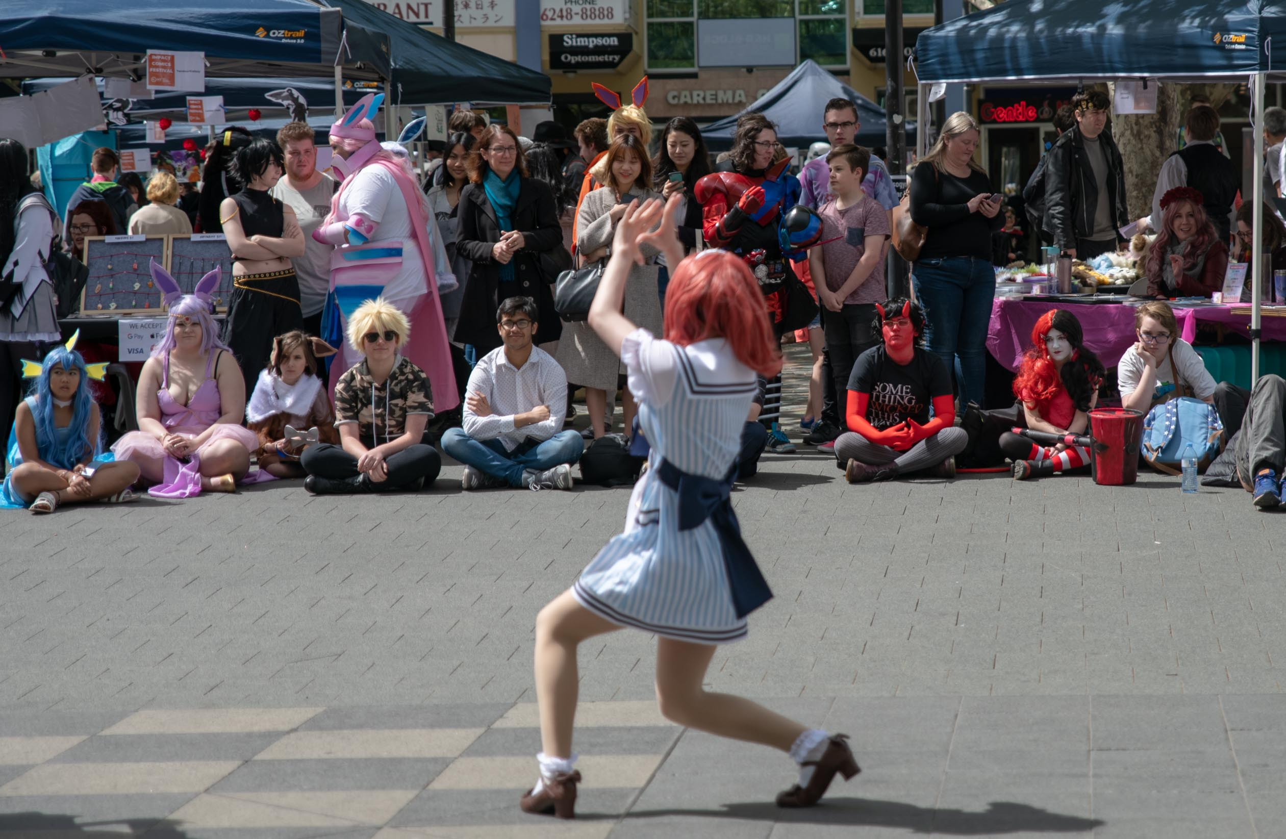 woman dancing, people watching at impact comics festival 2018