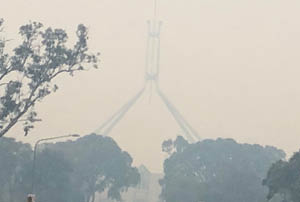 An image of Parliament House a midst the smokey haze.