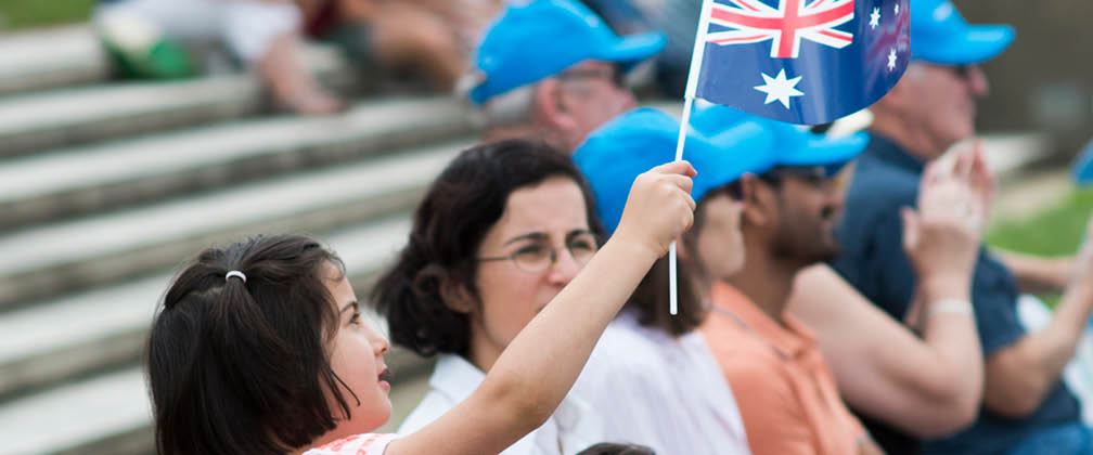 Child waving an Australian flag