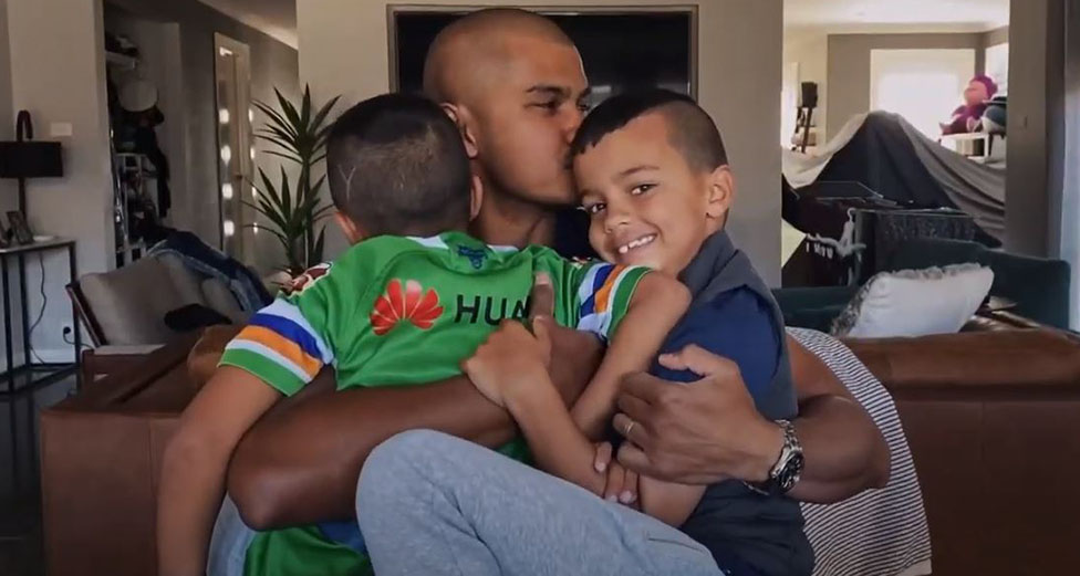 Dad with two boys hugging