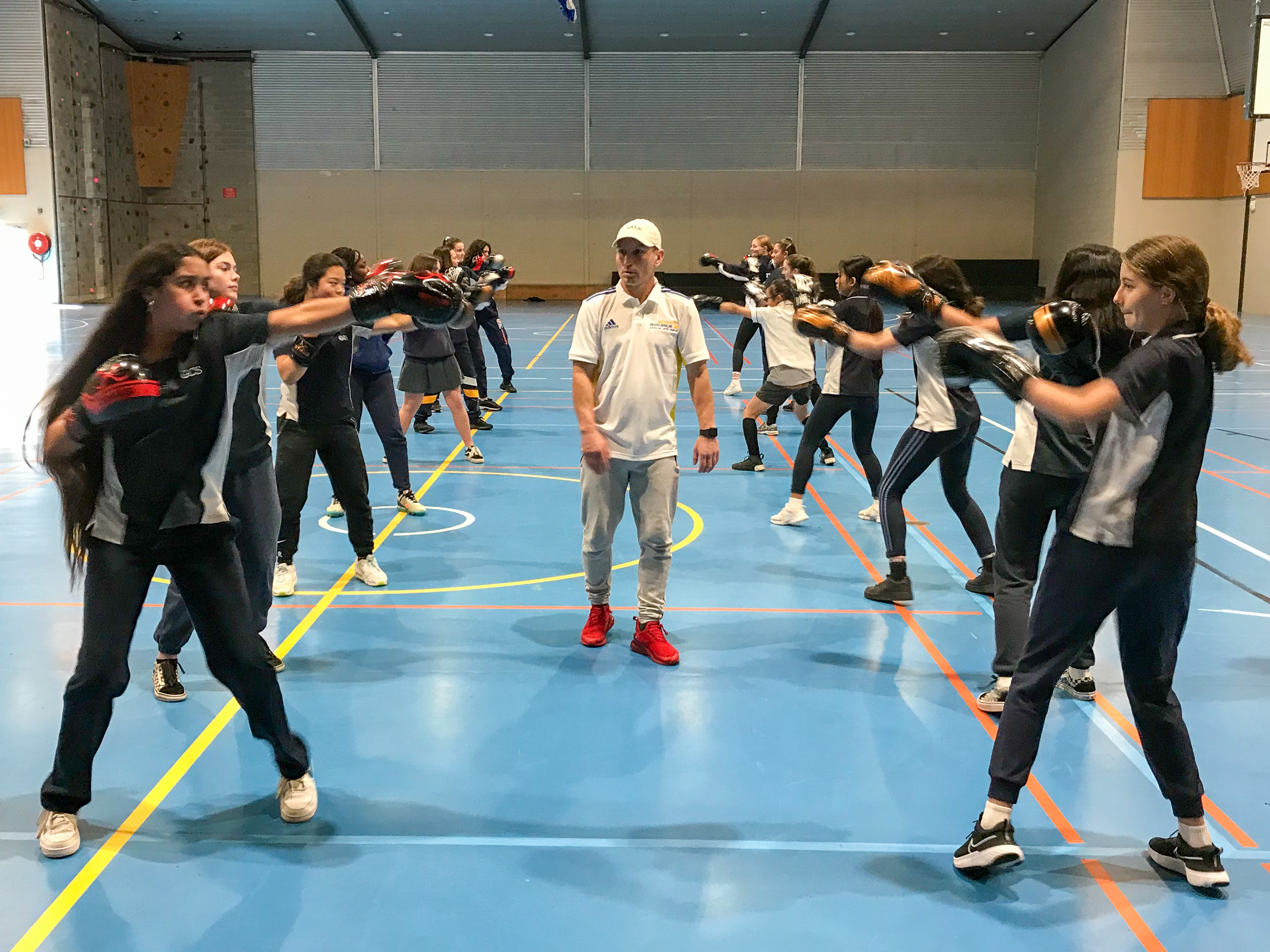 Female students line up in sparring rows