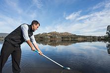 Man testing water at Lake Tugg