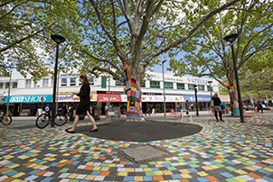 Girl walking through Garema Place
