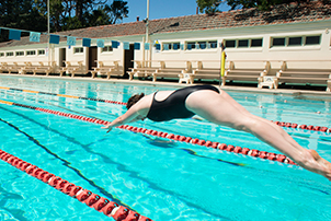 A woman diving into Manuka Pool.