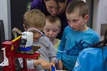 Children looking at 3D printing