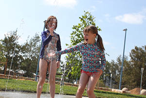 Children playing in a splash pad.