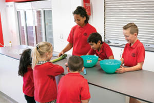 Children in a kitchen classroom.