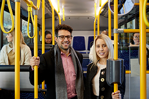 People using a bus to move around Canberra.