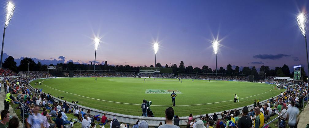 A crowd watching cricket at Manuka Oval