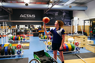 Basketball star Annabelle Lindsay using the ACTAS gym out at the Australian Institute of Sport.