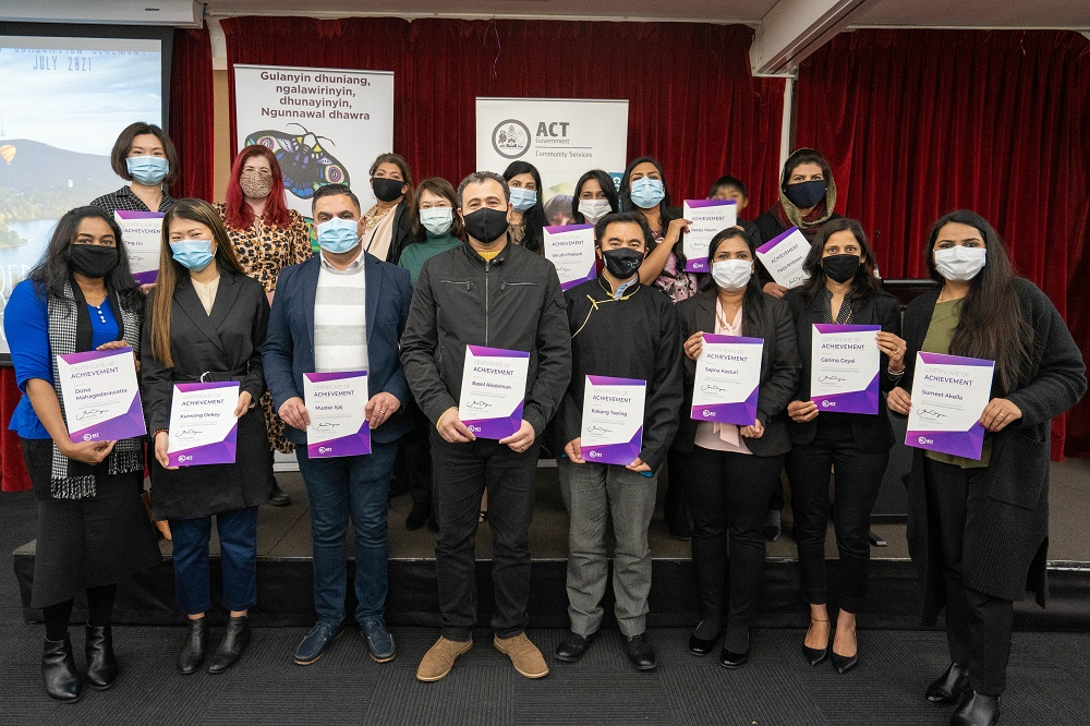 Recent graduates of the Work Experience and Support Program hold their graduation certificates