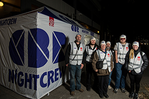 One of the CBR NightCrew volunteers walks through the city.