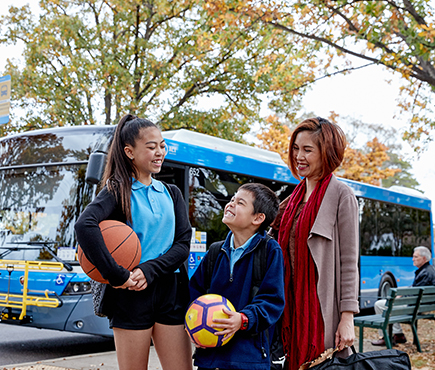 A family who has used buses to move around Canberra.