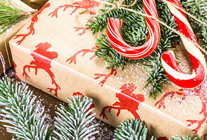 A present wrapped in paper with candy canes.