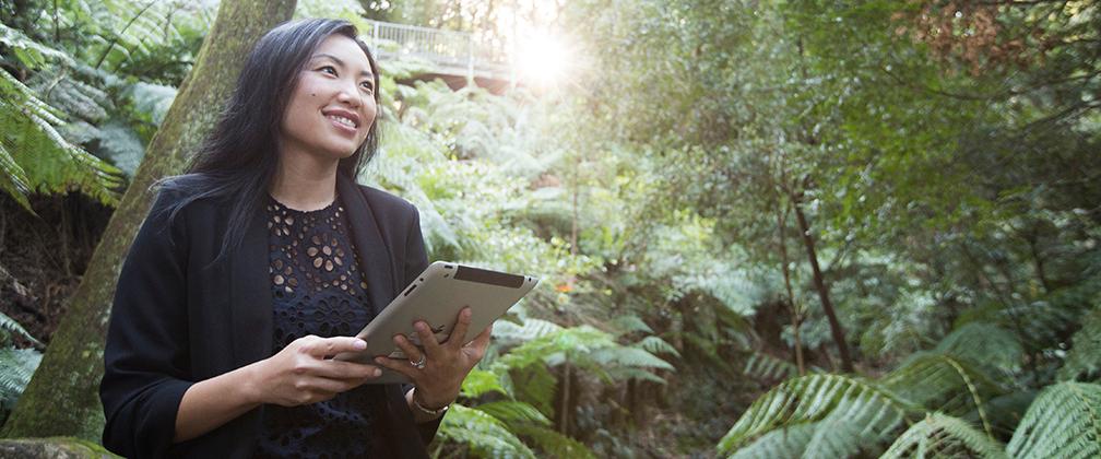 Girl in the botanic gardens on IPad