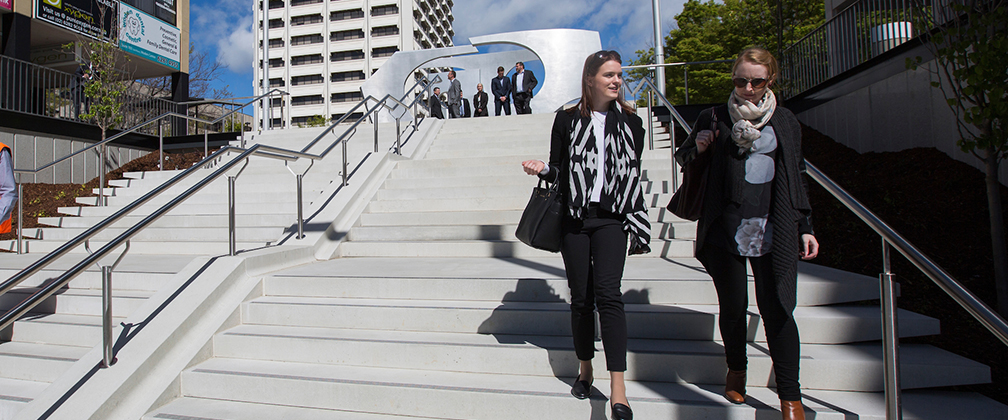 People using new stairs at Woden Interchange