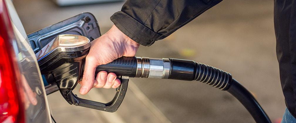 Man pumping petrol in his car.