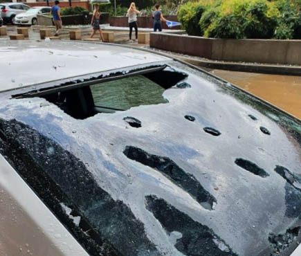 Car damaged by hail.