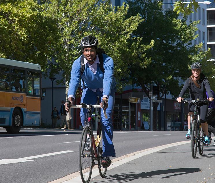 Man riding a bike in Canberra CBD