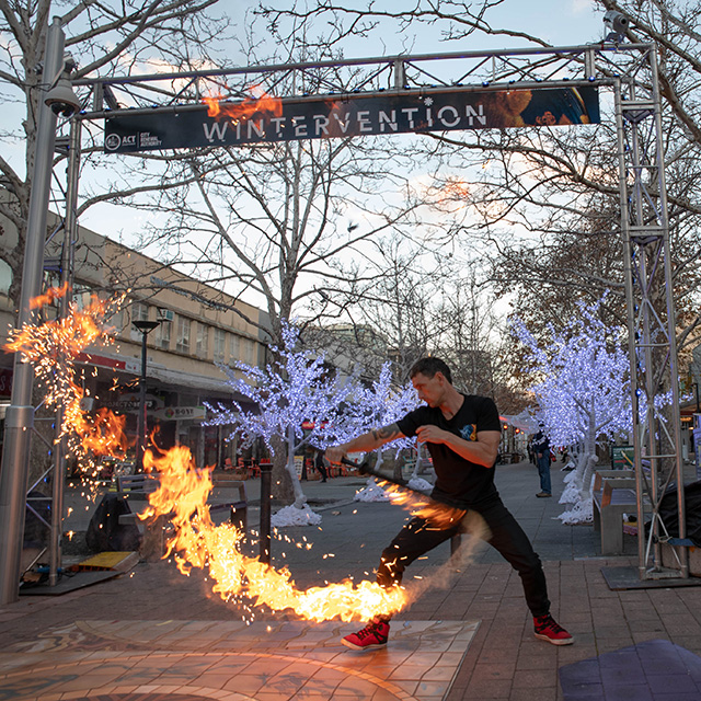 Neal Webb from Energy Entertainments demonstrates some of the moves from his fire performances at Wintervention this year.
