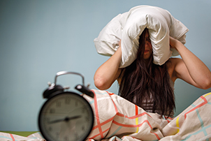 A woman is woken up by some noisy neighbours early in the morning.
