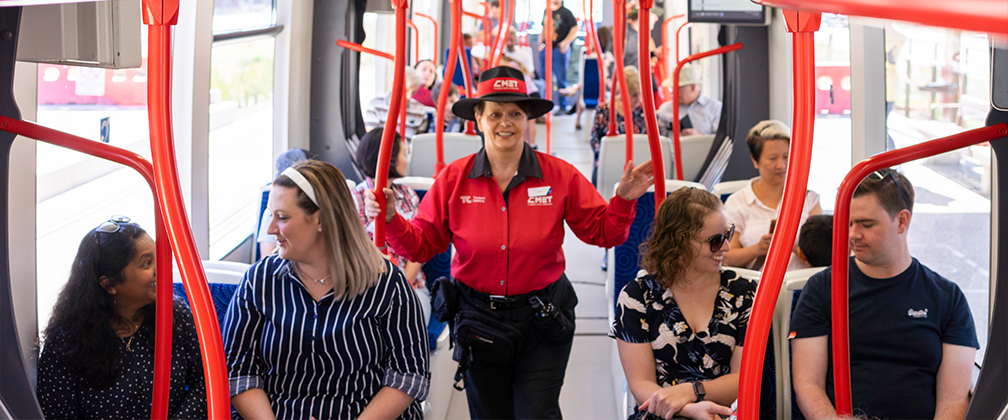 Passengers and Customer Service Officer travelling on light rail.