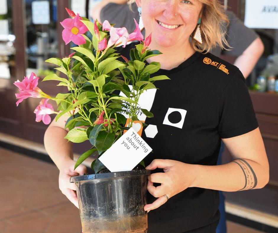 person holdin a pot plant