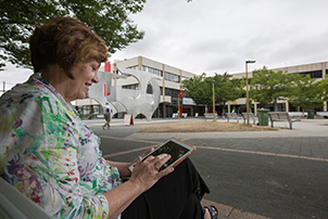 Woman using internet on a tablet