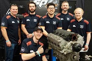 A group photo of CIT automotive apprentices representing Canberra  at the 2019 MotorEx Flying Spanners competition.