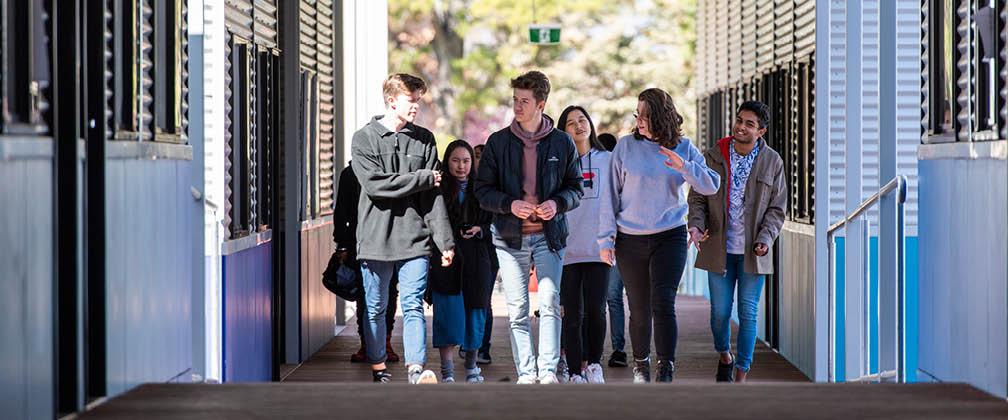 Students walking near classrooms.