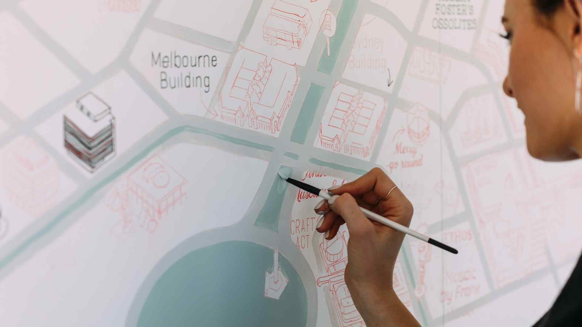 person painting a map of Canberra