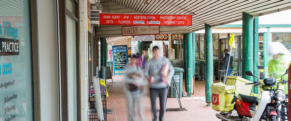 Two shoppers walking along at Kambah shops