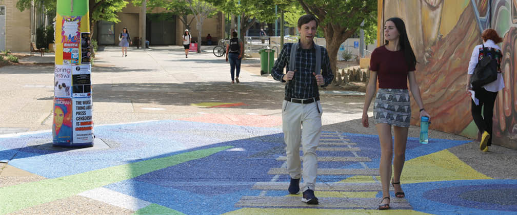 Male and female student in Woden
