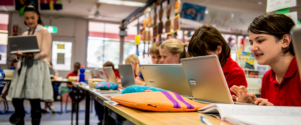 Teacher and students on laptops