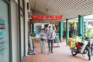 Two shoppers walking along at Kambah shops