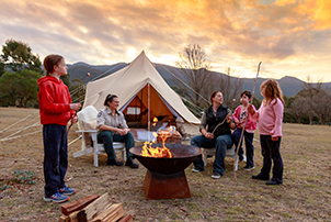 A family enjoys glamping at Tidbinbilla.