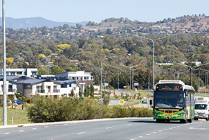 City bound Action bus driving along Cotter Road
