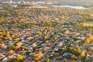 An aerial photo of Canberra homes and surrounding nature.