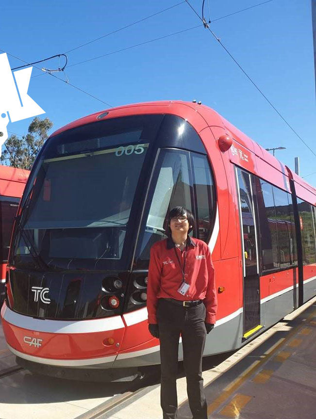 Kenneth, Customer Service Officer, standing in front of a light rail vehicle